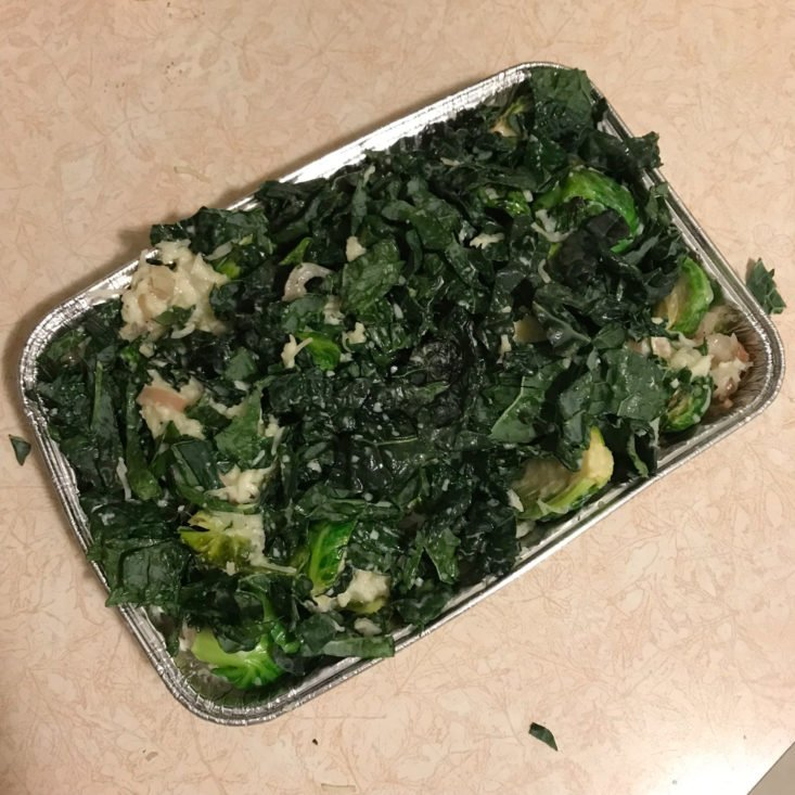 cooked brussels sprouts with sliced shallots in tin, mixed with cream, fontina, and kale