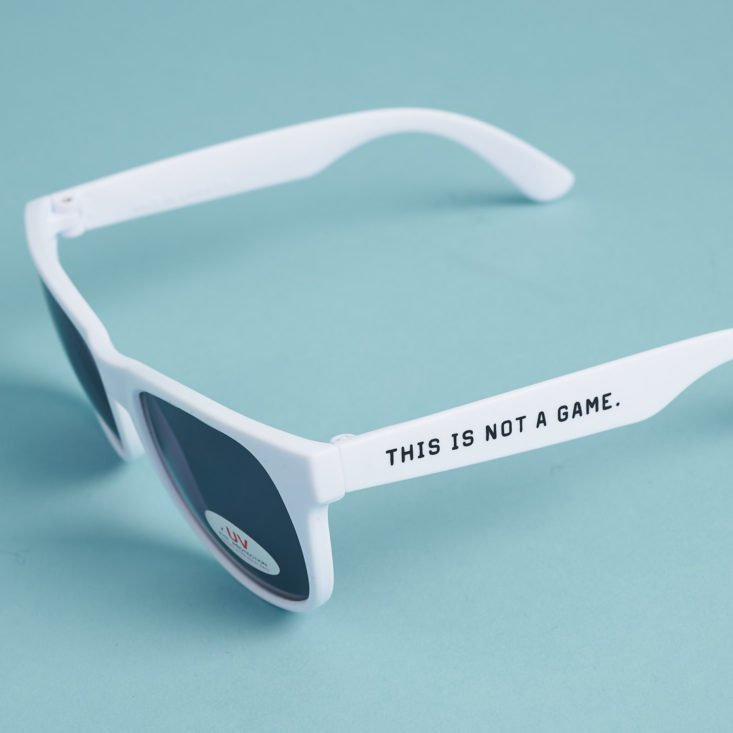 retro white sunglasses with saying on the side