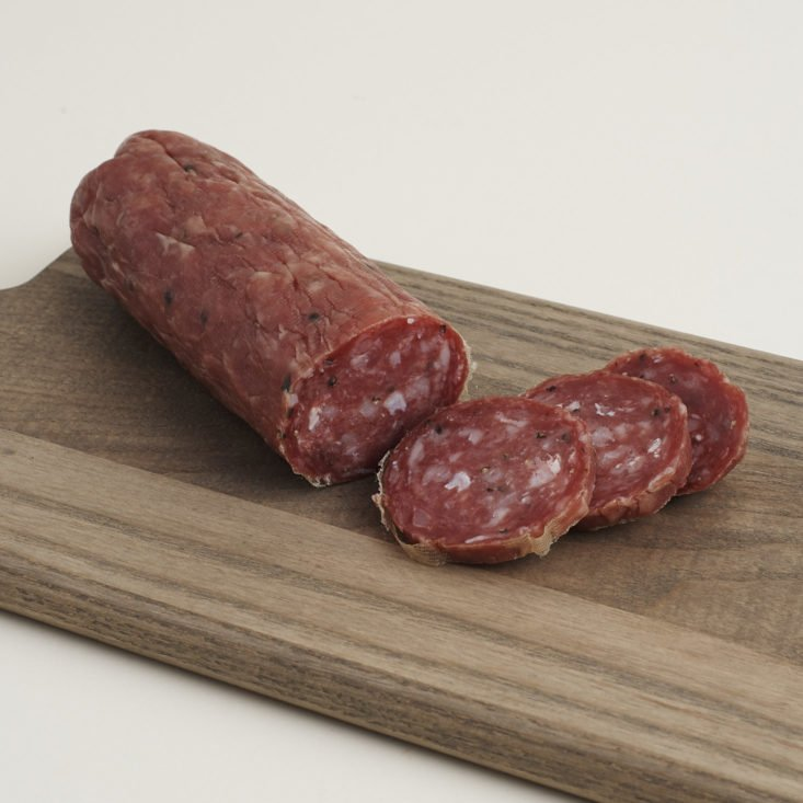 Cacciatore Salami from Parma Sausage sliced on a cutting board