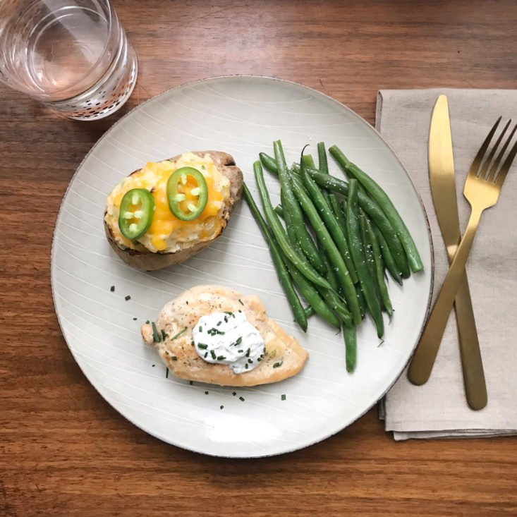 plated ranch chicken with jalapeno popper twice baked potato