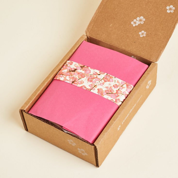 open Yuzen Box with pink tissue paper and cherry blossom band