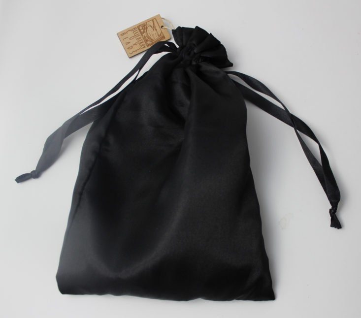 black silk pouch cinched