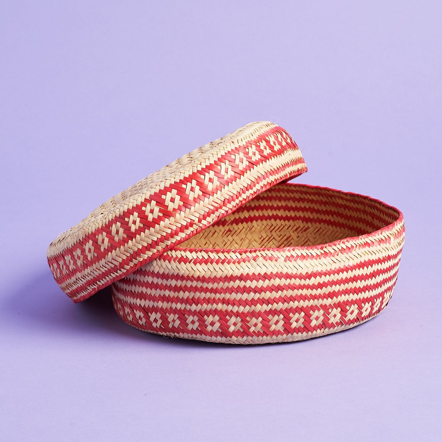 red and natural colored woven basket