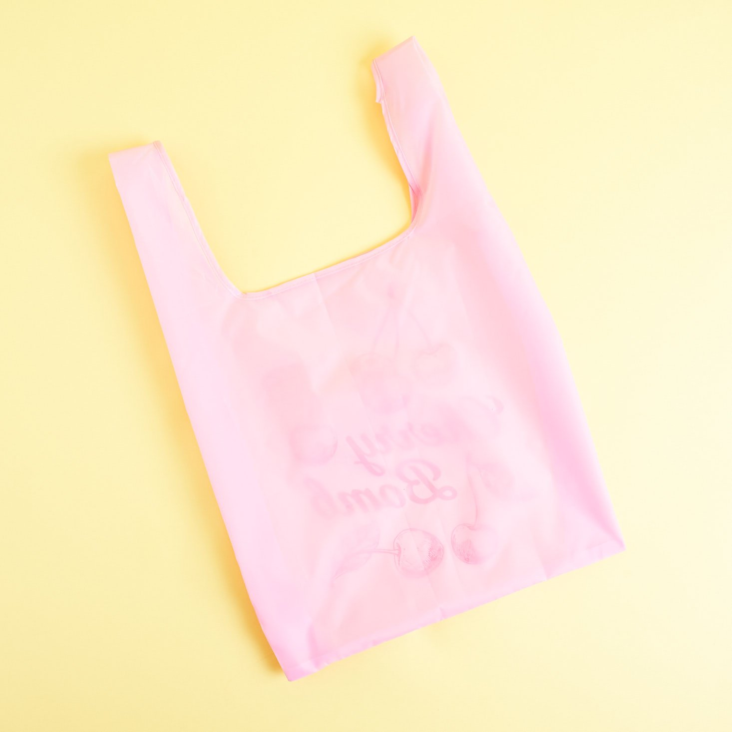 back of Pink Cherry Bomb reusable tote - blank
