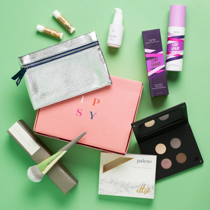 Ipsy Glam Bag Plus metallic pouch with makeup and skincare products